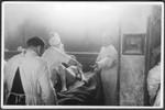 British medical personnel wash and disinfect survivors in Bergen-Belsen.