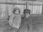 A young boy holding his younger brother in the Kovno ghetto.