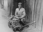 """Close-up of a Jewish vendor in the Kovno ghetto known as """"Hamster"""" for gathering and selling bread on the black market."""