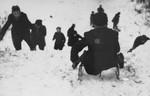 A group of Jewish children go sledding in the Kovno ghetto.