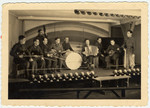 Concertmaster, Max Beker, a Jewish prisoner-of-war from Vilna, leads the tango orchestra of Stalag VIIIA.