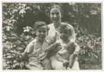 Vilma Grunwald poses with her two sons, John and Misa.