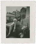 Misa Grunwald sits on the hood of an automobile a couple of months after his liberation from Mauthausen and shortly after his return to Czechoslovakia.