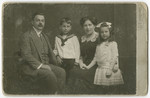 Studio portrait of the Eisenstein family.  From left to right are Otto, George, Matilda and Vilma Eisenstein.
