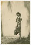 Portrait of Vilma Grunwald taken outside with her dress blowing in the wind.