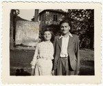 Two siblings stand in front of the children's home of Chateau de la Hille.