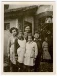 Group portrait of girls and staff at Home General Bernheim in Zuen, Belgium.