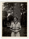 Rita Leistner poses in front of a tree at the children's home of Chateau de la Hille.