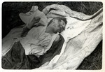 The corpse of a Polish victim of a German air raid lies on the ground in besieged Warsaw.