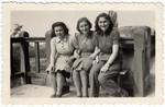 Three teenage girls sit on the terrace of the Home General Bernheim in Zuen, Belgium.