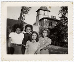 Portrait of four girls standing on the terrace of the children's home of Chateau de la Hille.