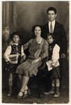 Studio portrait of a Romanian Jewish family.  Pictured are the Leibovitche family.
