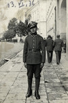 Moshe Volovelski poses on a sidewalk in his Polish army uniform.