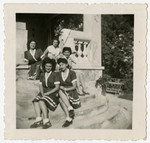 Five women sit together for a picture in Feldafing displaced persons camp.