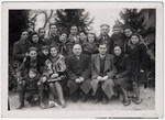 Group portrait of Jewish survivors from Zhetel who had fought with the Lenin Brigade, taken shortly after liberation.