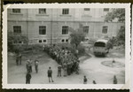 Jewish displaced persons wait outside a building in the [Graz displaced persons camp].