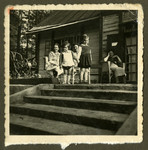 Members of the Bagriansky families relax outside a summer home in Kacerginai before the war.