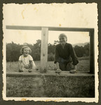 Rosian Bagriansky poses on a wooden structure with her nanny.