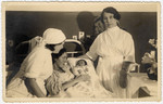 Two nurses in a Kaunas hospital attend to Gerta Bagriansky after she gave birth to her daughter Rosian.