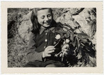 Rosian Bagriansky picks flowers on the grounds of the Selvino children's home.