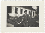 A rabbi and his wife pose in front of their home which also served as the town's synagogue.