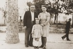Portrait of a Jewish DP family in a park in Cremona.