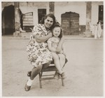 A Jewish DP child poses with a young woman in the Cremona DP camp.