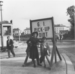 Friederike and Wolfgang Schaechter at a tram stop near the Enns displaced persons camp.