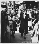 Helen Gutwirth walks down a street in Belgium with Freddy, an orphaned relative form Vienna whom the Gurwirth family was helping.