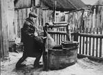 Judke (Yehuda) Levitt hides supplies in the well.