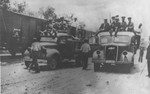 Romanian guards arrive on the backs of trucks in Targu-Frumos where the Iasi-Calarasi death train is making a stop on its journey.
