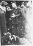 Soviet liberators witness burned corpses lying on the grounds of the Klooga concentration camp.