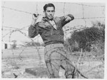 Haim Solomon poses next to the barbed wire fence surrounding the internment camp in Cyprus.