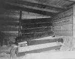 A room filled with unused wooden coffins in Bergen Belsen.