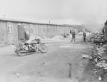 Survivors on a camp street in Bergen-Belsen.