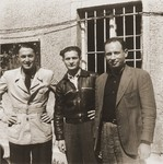 Three Jewish DPs, who survived both the Kovno ghetto and Dachau concentration camp, pose together at the Saint Ottilien Hospital displaced persons camp.