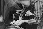 A Bergen-Belsen survivor washes her hands after her liberation.