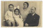 Studio portrait of a Romanian-Jewish family.  Pictured are Shneur, Tirza, Slima and Baruch Engler.