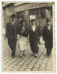 A Romanian Jewish couple walks to the synagogue together with the rabbi and his wife.