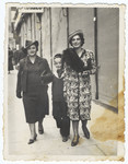 A Romanian Jewish family walks down a street in Cernauti.