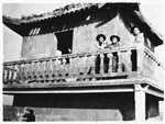 Three members of Betar pose on the balcony of a pagoda in the Hongkew ghetto.