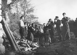 A group of Jewish teenagers stops for a snack on a farm near Vallon where they are hiding under the protection of MACE.