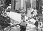 Young children play ouside the children's home in Vence.