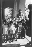 Julie Hermanova, a Czech Jewish nursery teacher, poses with a group of young children in the Vence children's home.