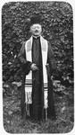 Portrait of Rabbi Leopold Deutsch wearing a prayer shawl and clerical robes.
