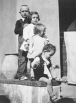 Four Jewish children stand in a row on the steps of the children's home in Vence.