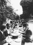 Older children eat a meal outdoors in Chateau de la Hille.