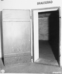 "The door to the gas chamber in Dachau.  It is marked ""shower-bath""."