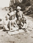 Three Jewish girls in hiding relax on a beach with a Romanian girlfriend.