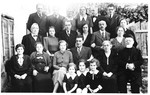 Group portrait of family members at the wedding of the Jewish couple, Silva Deutsch and Salamon Basch.